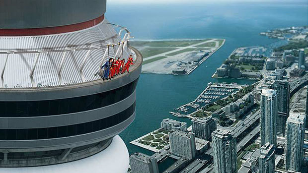 This artists rendition shows the CN Towers new EdgeWalk attraction. Set to open Aug. 1, it will allow visitors to walk outside the tower while being restrained by an overhead harness. (Canadian Press)