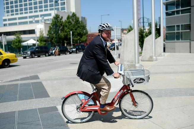 Brad Buchanan, the new director of the Denver Department of Community Planning and Development, rides a B-Cycle to a meeting last month. (Hyoung Chang, The Denver Post)