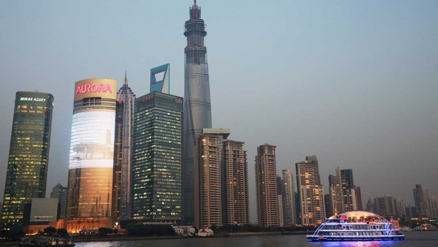 The Shanghai Tower soars above its neighbors on the Pudong skyline in Shanghai. When completed next year, the 2,073-foot-tall tower will officially become the world's second-tallest building. (Credit: Chicago Tribune)