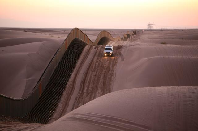 Fence on the US-Mexican border at Algodones Sand Dunes, California. Image via Wikipedia.