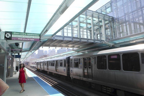 An inbound train passes under the sky bridge at the CTAs new Morgan station on the Near West Side. (Chuck Berman, Chicago Tribune / May 29, 2012)