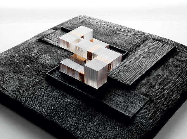 For the Duchess Estates model, Allied Works set cast resin, acrylic, and brass atop charred pine. Image via fastcodesign.com.