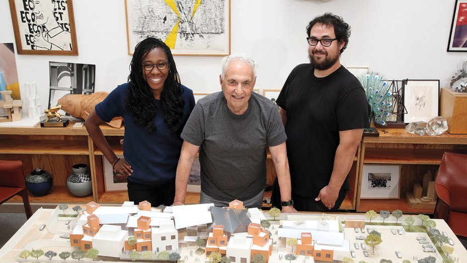 Frank Gehry — here with Gehry Partners architects Precious Aiyeloja and his son Sam — proudly presenting a model of the proposed 50,000-square-foot campus for the Childrens Institute in the Watts neighborhood of Los Angeles. (Photo: Glenn Marzano / courtesy of Childrens Institute, Inc.; image via hollywoodreporter.com)