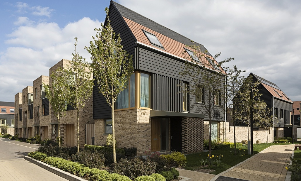 Abodes housing development in Great Kneighton, near Cambridge. Photograph: Tim Crocker. Image via theguardian.com.
