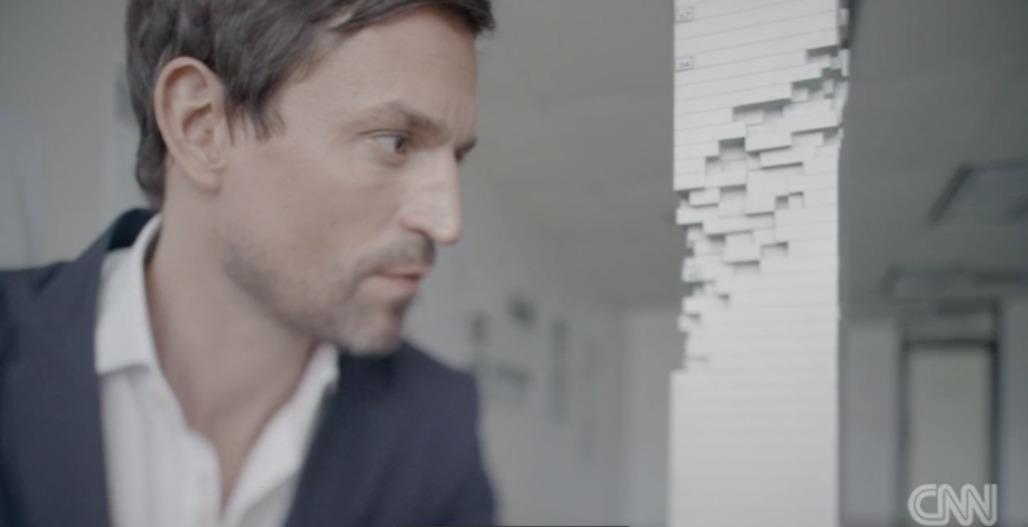 Ole Scheeren with a model of MahaNakhon. Screenshot: via CNN.