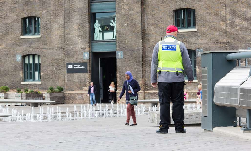 Pseudo-public space … a private security guard in Granary Square, King's Cross. Photograph: Teri Pengilley for the Guardian
