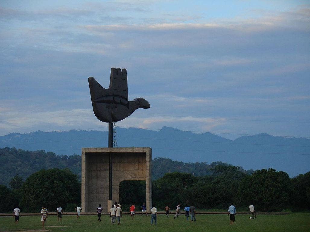 Chandigarh is located near the Sivalik Hills. Shown here is the Open Hand Monument with the Shivaliks visible in the background (via Raakesh Blokhra - Flickr)