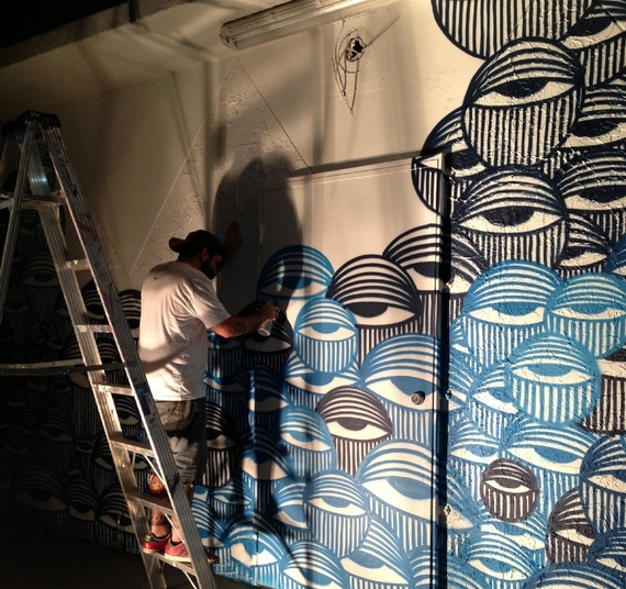 "In Miamis Wynwood Arts District, David Anasagasti works on his ""Ocean Grown"" mural, a mural at the center of a copyright infringement dispute with American Eagle Outfitters. (via The Atlantic)"