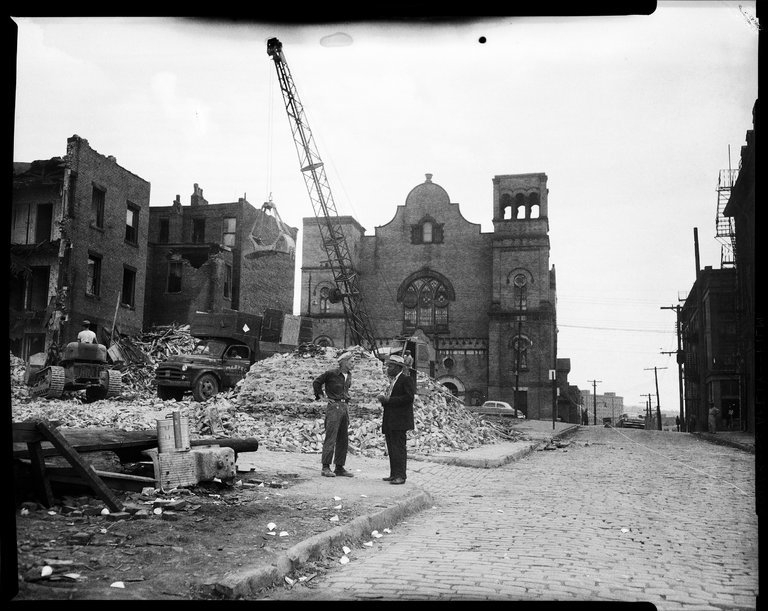 A demolition zone in the Hill District in Pittsburgh in 1957, in an area of historically African-American neighborhoods. (Charles Teenie Harris/Carnegie Museum of Art, via Getty Images)