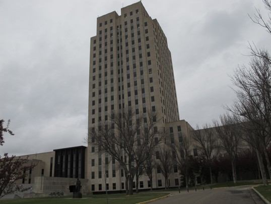 "(Dale Wetzel/ Associated Press ) - This photo, taken Thursday, April 19, 2012, shows the North Dakota Capitol, whose main tower is almost 250 feet high. The Republican majority leader of the Minnesota House on Thursday described the North Dakota Capitol building, which is located in Bismarck, N.D., as ""embarrassing"" and compared it to an insurance office. His remarks came during debate in the Minnesota Legislature in St. Paul, Minn., about whether to set aside money for repairs to the..."