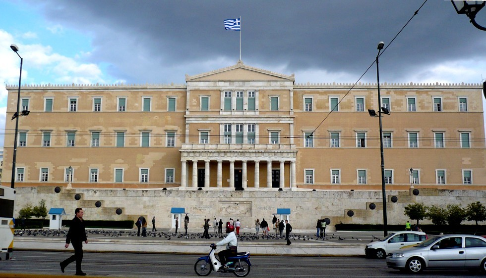 """The Hellenic Parliament in Syntagma Square in Athens has been the site of numerous demonstrations over the last few months, as Greece became the first developed country to default on its loans to the IMF. Yesterday, Greek voters gave a resounding """"No!"""" in a referendum over accepting bailout conditions from the Troika and further austerity. Credit: Wikipedia"""