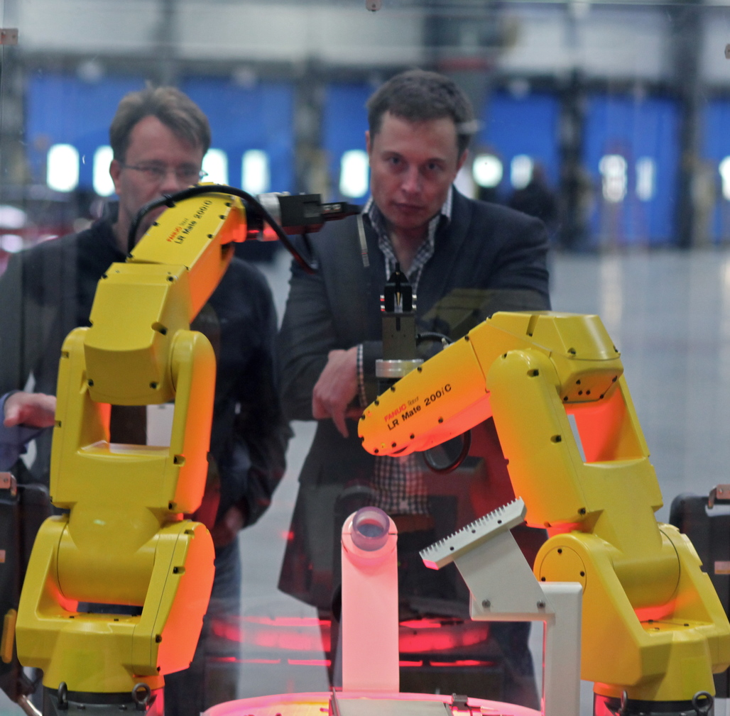 Elon Musk supervising an assembly demo at what-is-now the Tesla factory. Credit: Wikipedia