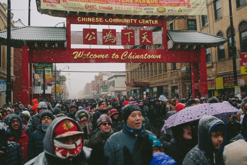 Crowds gathering in Chicagos Chinatown for Lunar New Year festivities. Photo via nextcity.org.