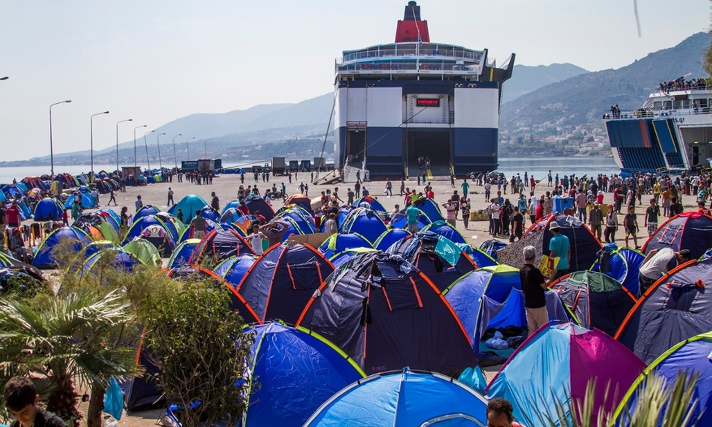 Tents line the main port in Lesbos, as migrants await transfer to the Greek mainland. Photograph: Tyler Jump/International Rescue Committee. Image via the guardian.com.