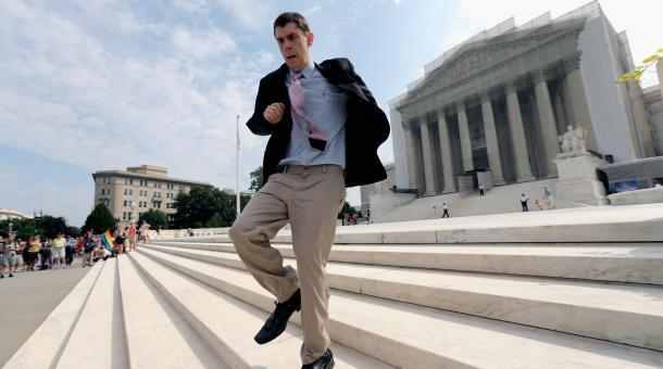 In this widely-circulated image, Scotusblog.com intern Dan Stein ran with news of affirmative action ruling front of the U.S. Supreme Court building June 24, 2013 in Washington DC. Soon, the question of internships - unpaid internships especially - may make it higher up the legal ladder. (Marketplace; Win McNamee/Getty Images)