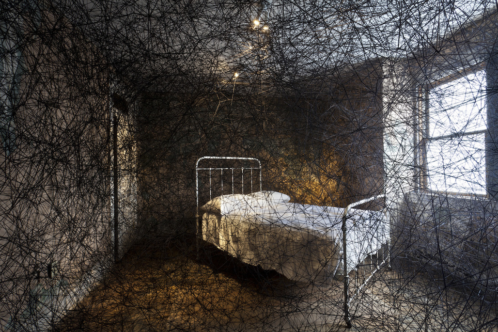 Installation view of Chiharu Shiota's 'Trace of Memory' at the Mattress Factory. Image via hyperallergic.com.