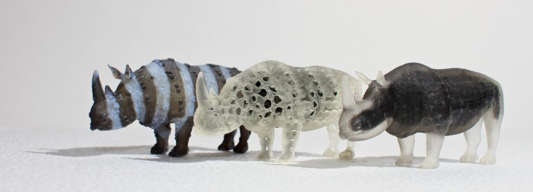 A zebra-like textured rhino with spiky skin, a porous rhino and an opaque rhino with a transparent shell 3D printed with a multi-material printer. Courtesy of MIT Computational Fabrication Group.