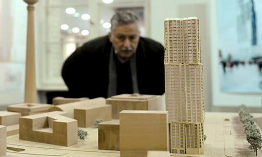 A journalist looks at the model of the Hines tower, right, the construction of which is expected to start in 2015. (The Guardian; Photograph: Britta Pedersen/Corbis)