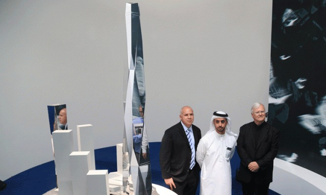 Gordon Gill and Adrian Smith standing with their client next to a model of the massive Burj 2020 district, which was revealed in Dubai this week. (Image via MEConstructionNews.com)