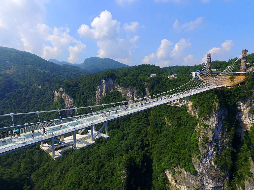The bridge, designed by Israeli architect Haim Dotan, spans across the Zhangjiajie Grand Canyon in Chinas Hunan province. (Image: Visual China Group/Getty Images via npr.org)