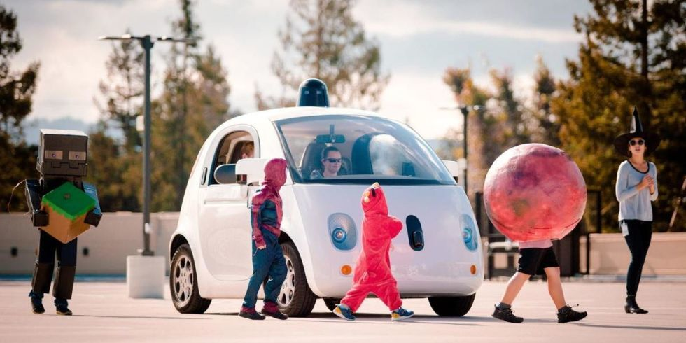 One of Googles driverless cars brakes for Halloweeners. Image via popularmechanics.com.