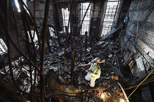Interior of the Mackintosh Library after the fire. Image credit Jeff J Mitchell/Getty, via dailyrecord.co.uk.
