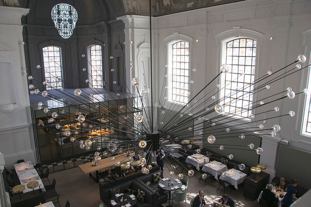 .PSLABs chandelier at The Jane restaurant, housed in a former chapel for a military hospital in Antwerp, Belgium. Photo courtesy of .PSLAB.