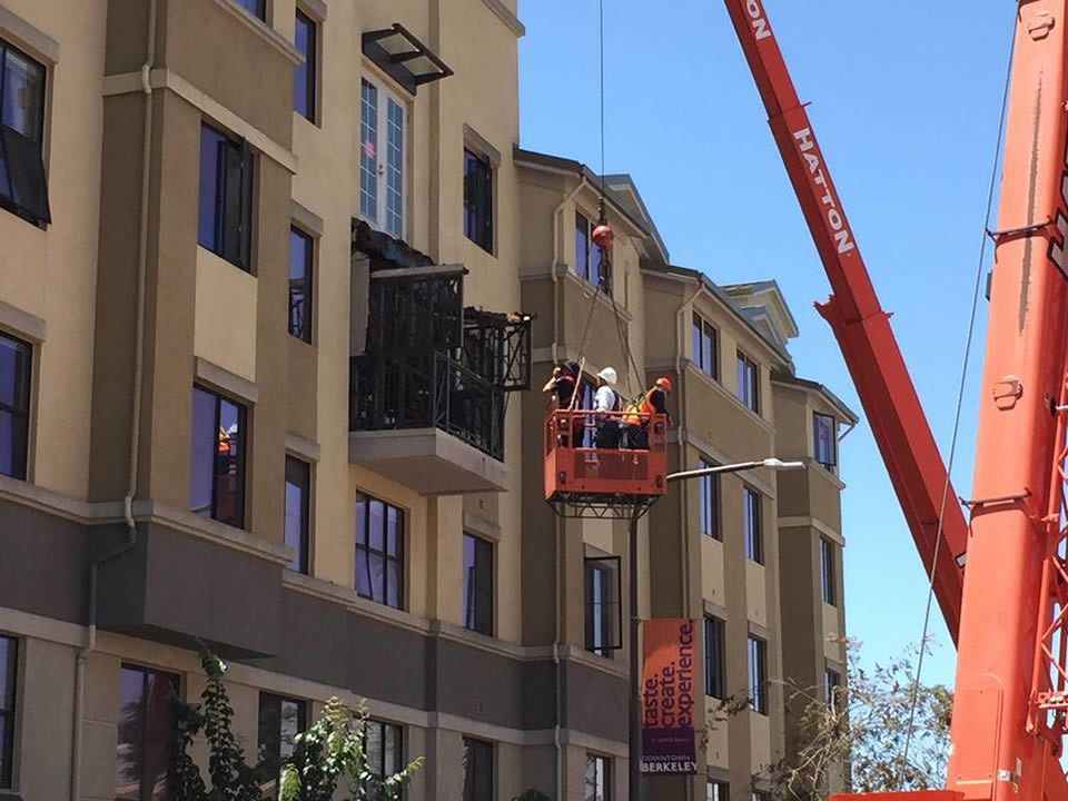Crews examine a balcony that collapsed and killed and injured several people in Berkeley, Calif. on June 16, 2015. KGO-TV/Elissa Harrington