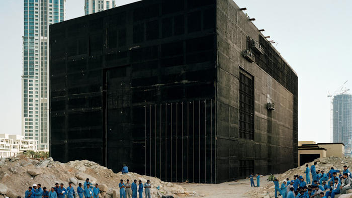 Bas Princen coolly eyes a cooling plant being built in Dubai in 2009. Beyond, more construction. (via latimes.com; Photo: Bas Princen / Barbican Art Gallery)