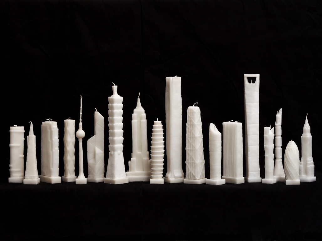 """Flammable"" by architect Jingjing Naihan Li scales down the worlds most celebrated skyscrapers into wax candles. Image via naihanli.com"