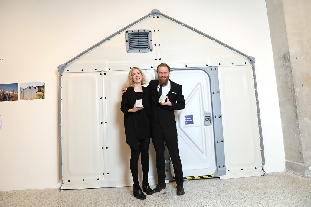 The winners in front of part of their design. Image: Getty Images