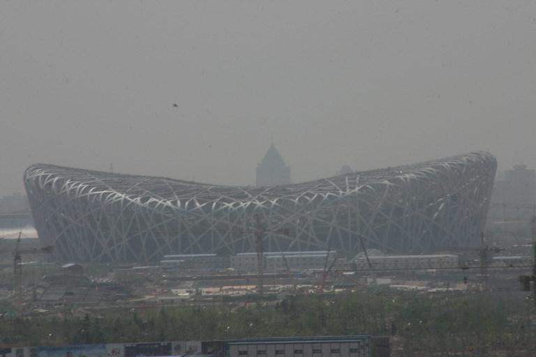 Smog obscures Heurzog & de Meurons Bird Nest. Image via wikimedia.org