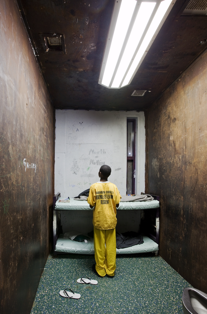 A 12-year-old in his cell at the Harrison County Juvenile Detention Center in Biloxi, Mississippi. The window has been boarded up from the outside. The facility is operated by Mississippi Security Police, a private company. In 1982, a fire killed 27 prisoners and an ensuing lawsuit against the authorities forced them to reduce their population to maintain an 8:1 inmate to staff ratio.