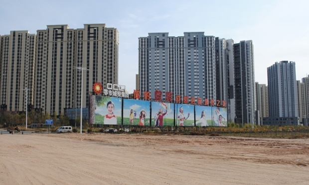 A development on the outskirts of Kangbashi, Ordos. (via theguardian.com; Photograph: Adam James Smith)