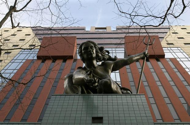 Portlandia statue outside of Michael Graves Portland Building. Image via The Oregonian.
