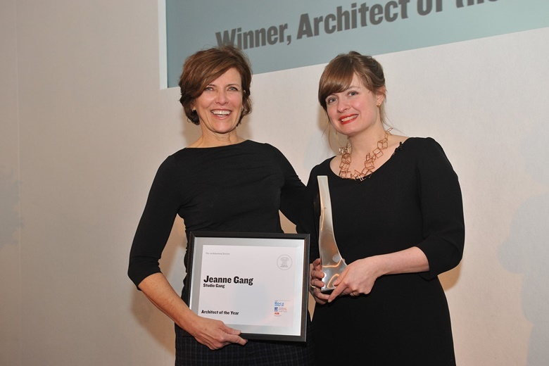 Jeanne Gang receives the award from Christine Murray, editor of The Architectural Review. Image via architectural-review.com.