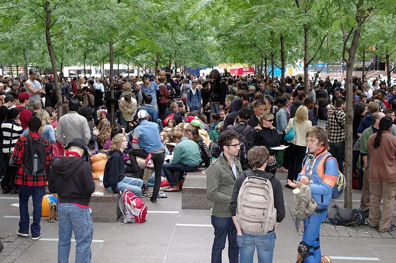 Zuccotti Park is home to two sculptures, including Mark di Suveros Joie de Vivre, seen here in the background via Wikimedia Commons