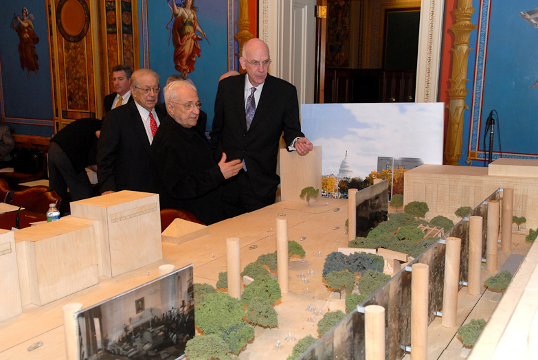 Frank Gehry and members of the Memorial Commission view model of Gehrys Eisenhower proposal. Image via carnageandculture.blogspot.com.