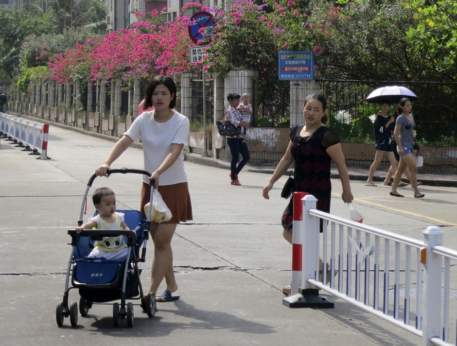 A woman pushes a stroller in a suburb of Zhuhai in southeastern China. (James Pomfret / Reuters)