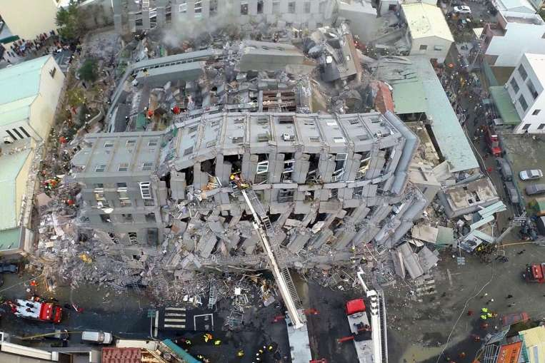 The collapse of the Wei-guan Golden Dragon Building in Tainan during the recent 6.4-magnitude earthquake has reportedly killed at least 24 people, with dozens still missing. Rescue workers discovered oil cans within the buildings exposed concrete structure. The cans appear to have been used as cheap fillers in beams. (Photo: Xinhua)