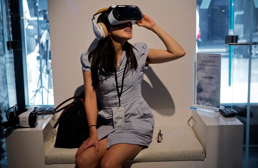 A woman wears Samsungs virtual-reality headset. Image from Bloomberg News, via wsj.com.