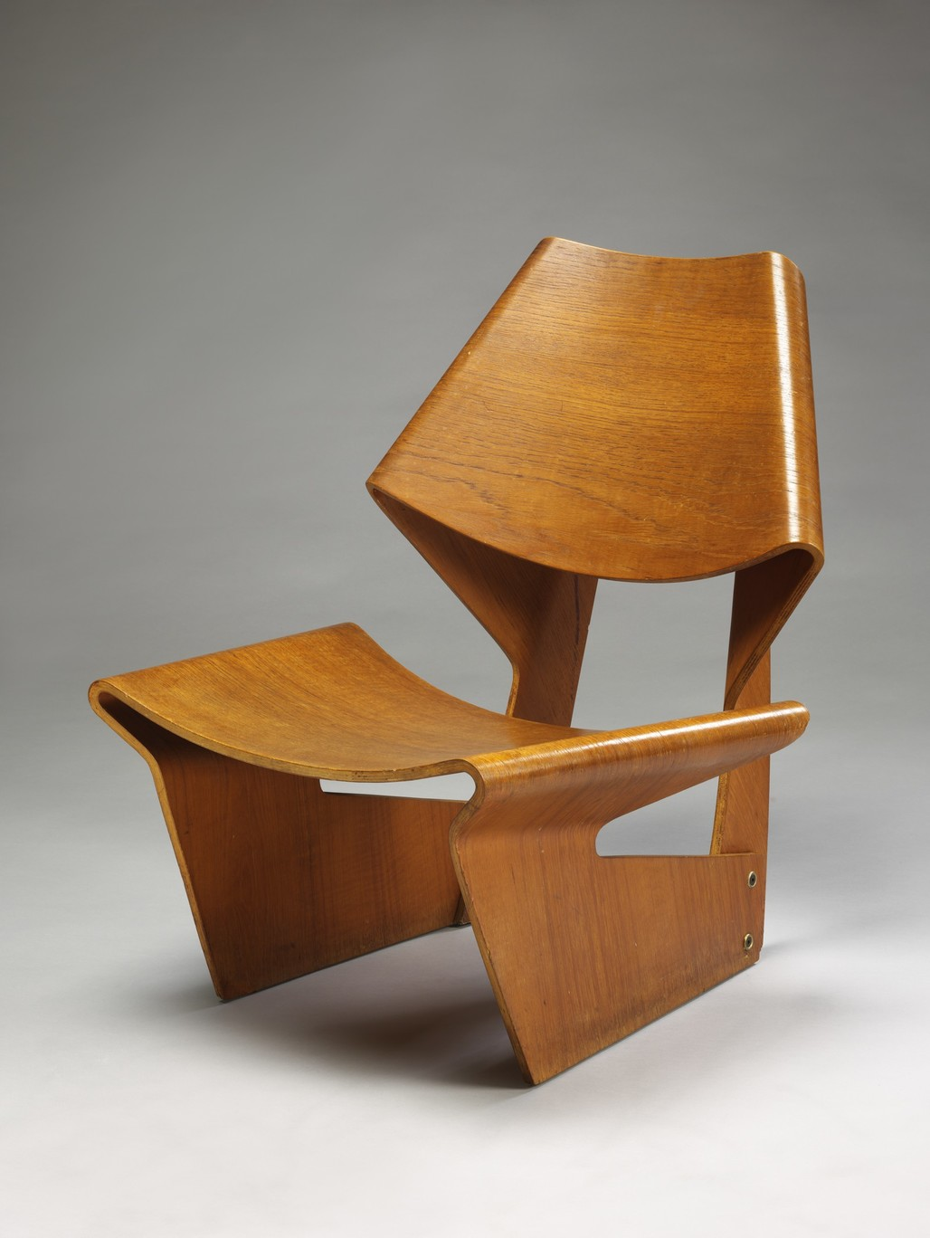 Molded plywood chair designed by Grete Jalk, 1963. Photograph © Victoria and Albert Museum, London.