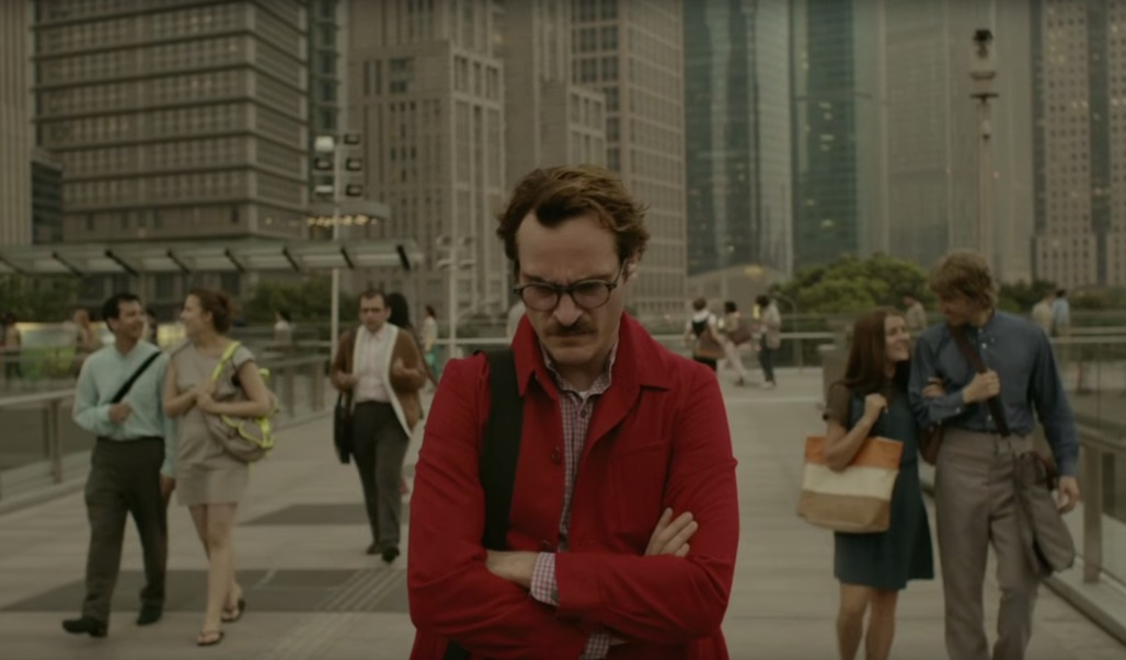 "Joaquin Phoenix walks through a future Los Angeles, gloomy in spite of the lack of cars and efficient public transport. Image from ""Her"""