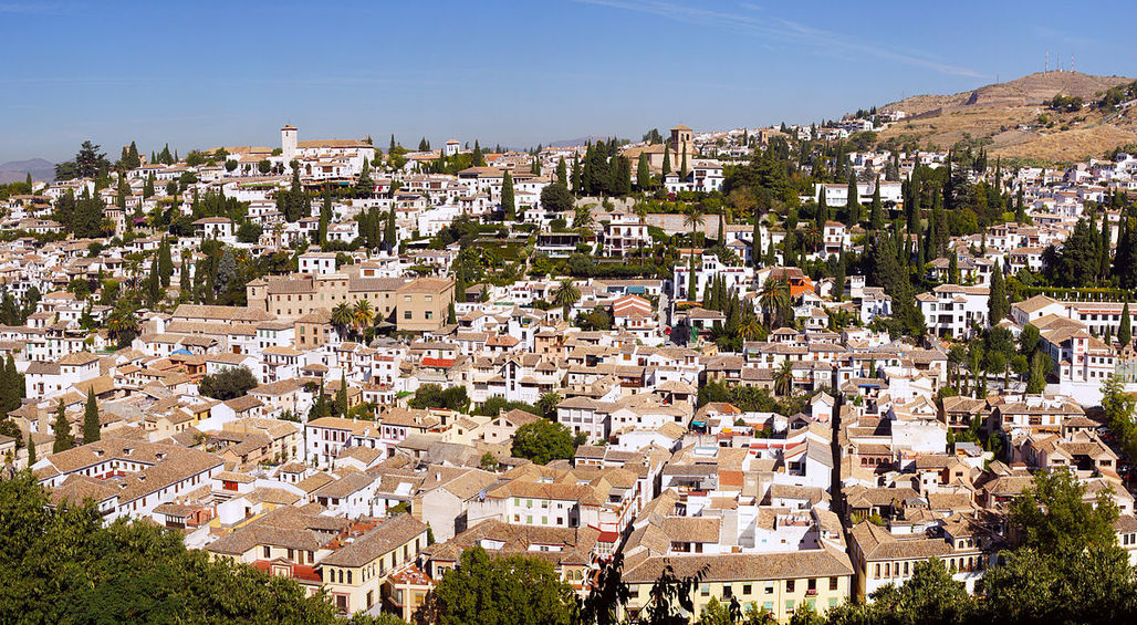 The Albayzín neighborhood in Granada, Spain, which has a multitude of cypress trees that might be a culprit to Granadas pollen-laden air. Photo: Bert K. via Wikipedia.