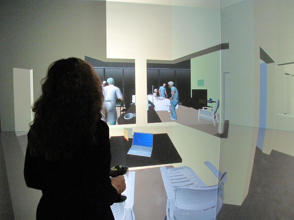 Dr. Eve Edelstein of NSAD, in a full-scale 3D hospital mockup in the virtual reality StarCAVE at Calit2/UCSD, assesses clinical avatars evidence-based design to minimize medical errors. Photo credit: Erick Jepsen, Calit2/UCSD.