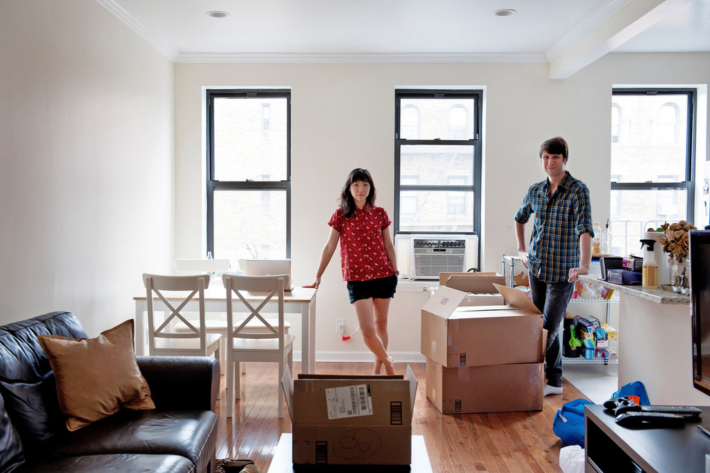 """Kathleen Kim and Brian Witte moved into a three-bedroom, one-bath rental in leafy Sunnyside, Queens, after giving up on finding suitable quarters in Brooklyn. Hesitant at first about the move, they find they like the """"small town in the big city feel,"""" Mr. Witte says. Credit Emily Andrews for The New York Times"""