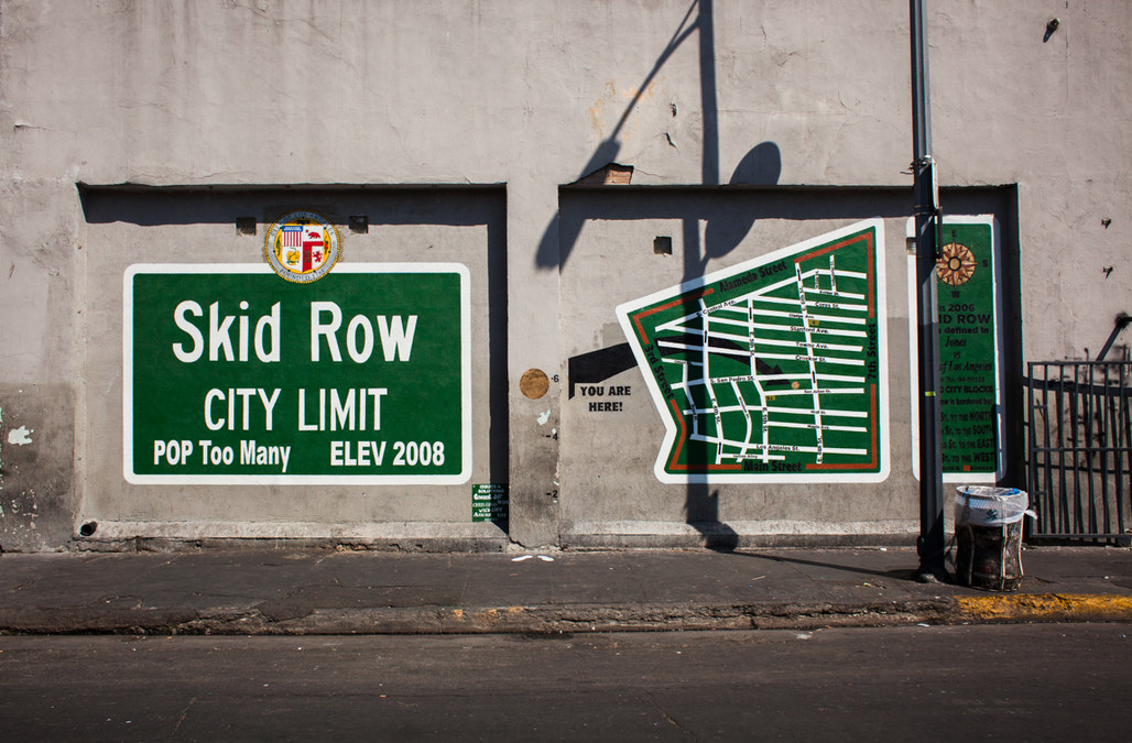 A mural in Skid Row, an area of LA that has traditionally been home for much of the citys homeless population but which is currently gentrifying. Image via wikimedia.org