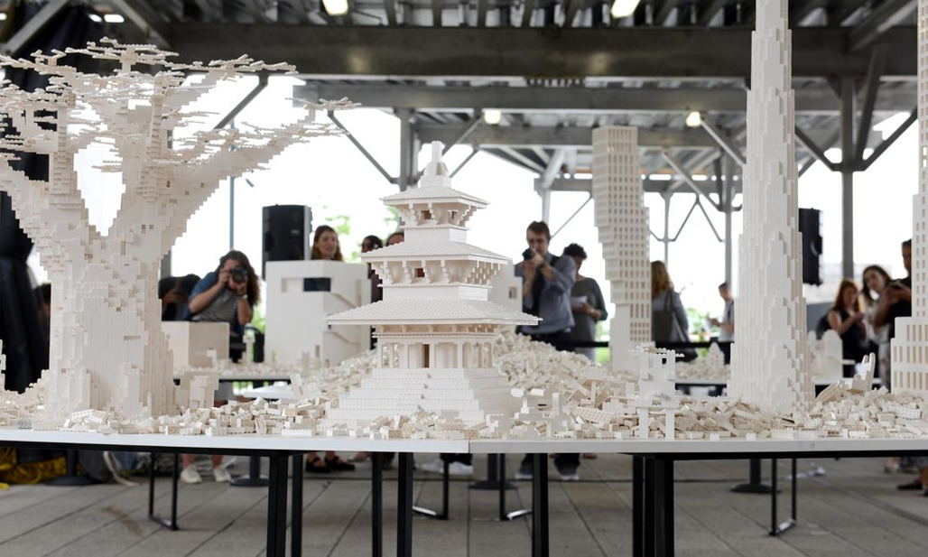 People constructing a utopian city out of legos for the Collectivity Project, by Olafur Eliasson and hosted by the High Line. Credit: the High Line