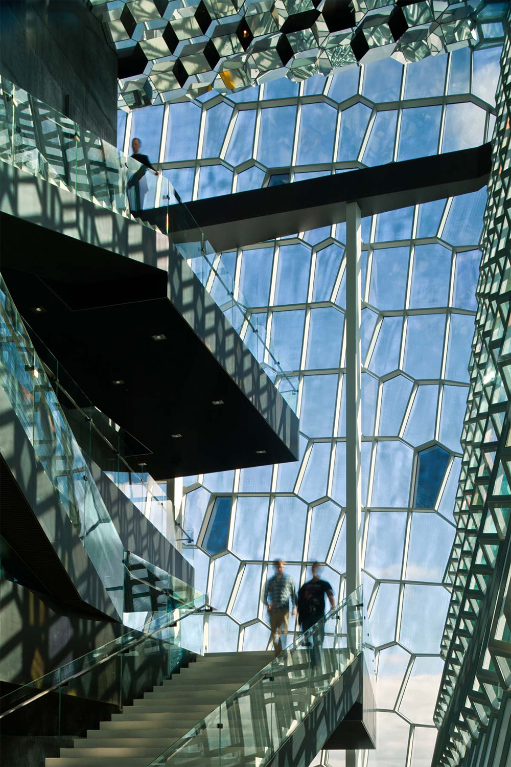 Certainly not trash: one of Eliassons most iconic ventures into the architectural realm is his facade for the Harpa Reykjavik Concert Hall designed by fellow Danes, Henning Larsen Architects. (Image via henninglarsen.com)