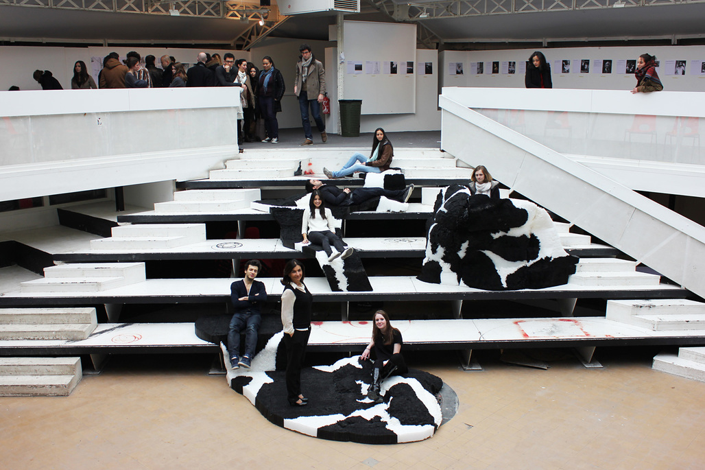 The Straw-K team poses with their installation among students at the Ecole Spéciale d'Architecture hall in Paris. Straw-K recently won the Young Talent Prize in the Africa Design Award 2014.